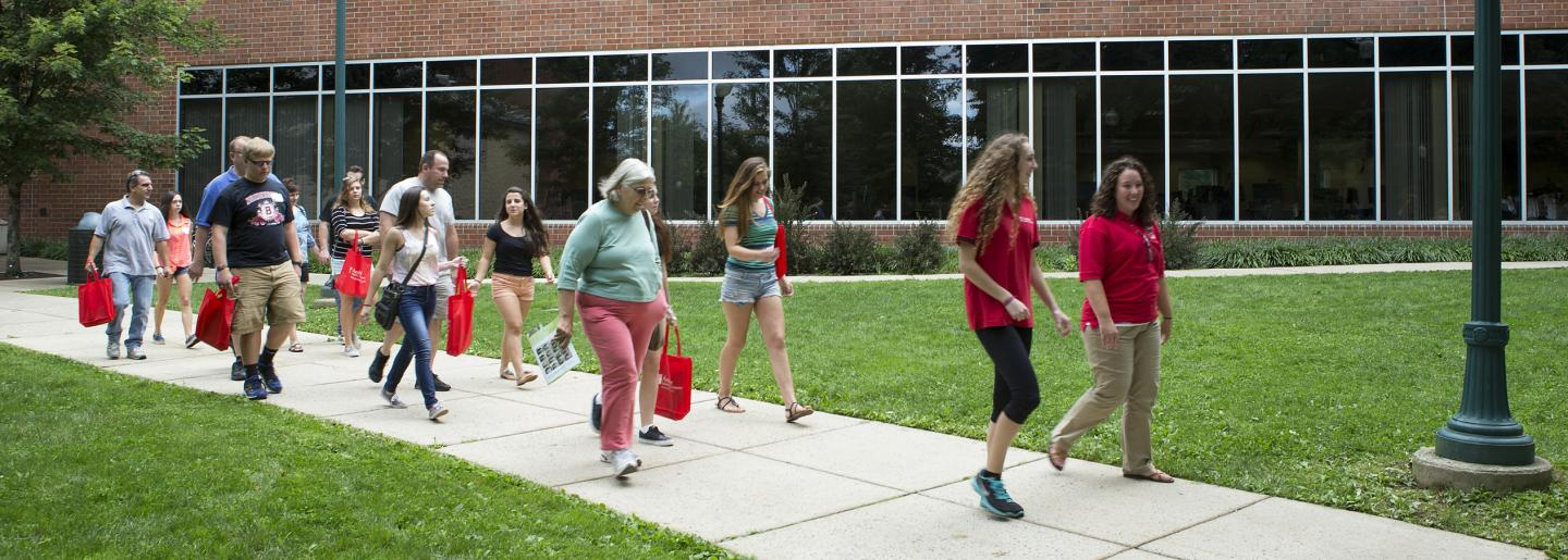 Visitors take a tour of campus at Temple University Ambler Summer Open House
