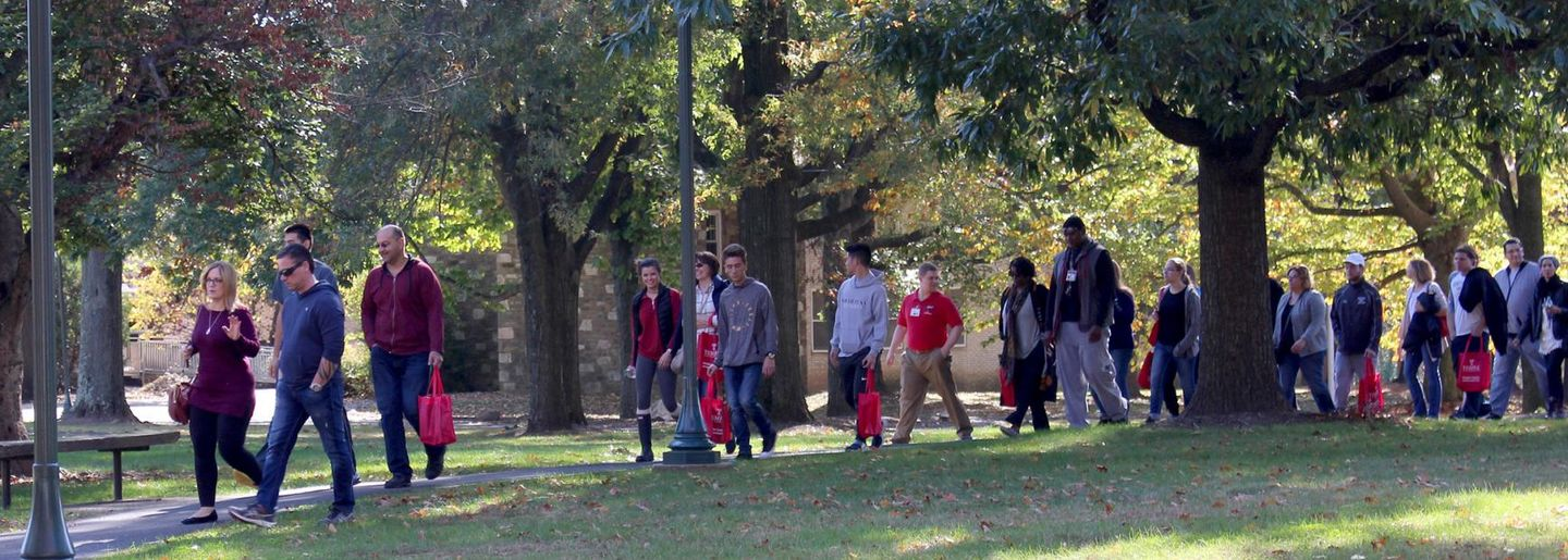 Visitors take a tour of campus at Temple University Ambler Fall Open House.