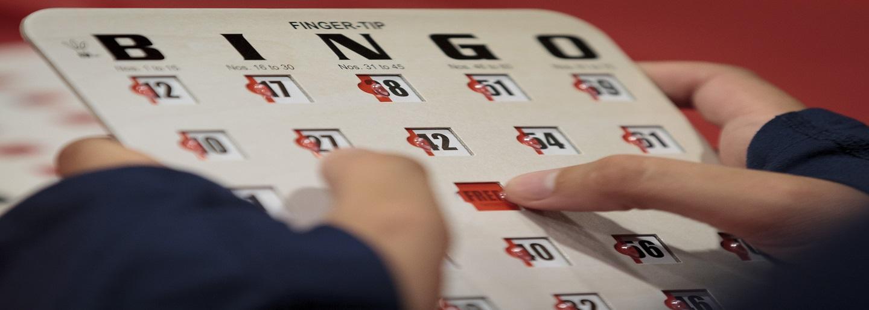 Hands holding a bingo card.