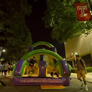 students in an inflatable