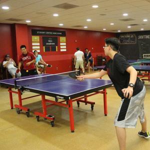students playing ping pong