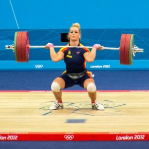 Woman doing Olympic lifting exercise.