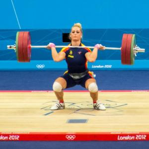 Woman doing Olympic weightlifting exercise.