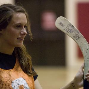 woman with floor hockey stick