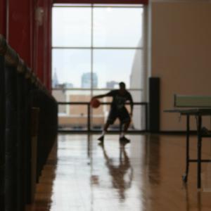male playing basketball