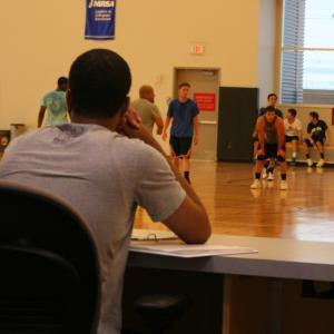 males playing basketball