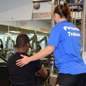 personal trainer helping participant