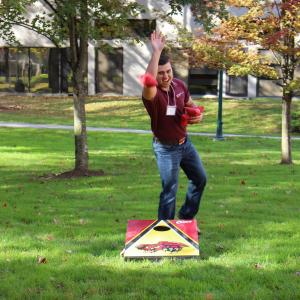 Take part in the Corn Hole Contest in the Red Barn Gym at Temple University Ambler