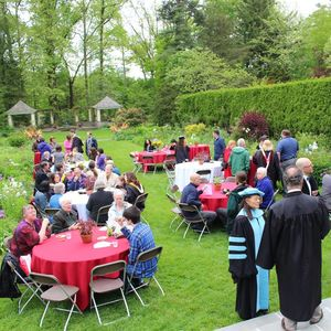 Students, faculty, staff and parents enjoy the gardens during the Graduation Reception at Temple Ambler.