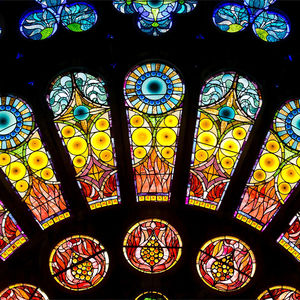 Stained glass image of the half rose window at Temple Performing Arts Center