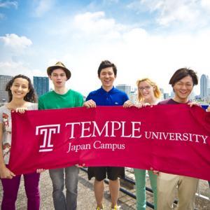 TUJ students holding TUJ flag