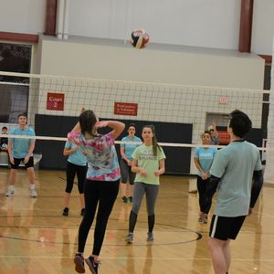 Girl Serving a Volleyball