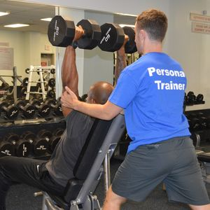Personal Trainer Assisting Patron