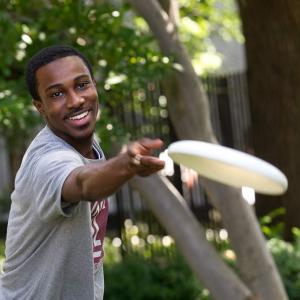 Temple student playing frisbee
