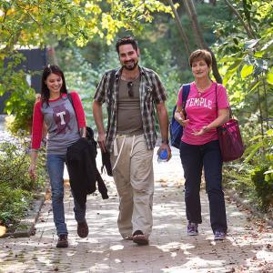 Family walking through Ambler Campus