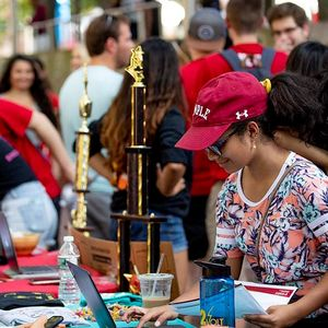 Students gather around and behind a table at Templefest 2019