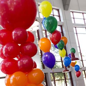 Rainbow balloons hanging in the student center atrium.