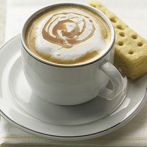 Coffee cup with cookie