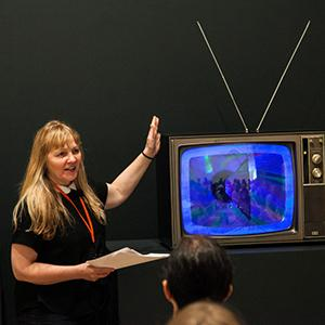 Chrissie Iles with a TV