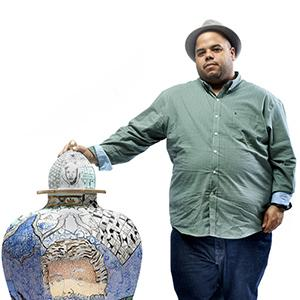 Roberto Lugo with one of his ceramic vessels