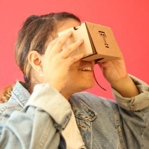student looking through 360 video screening glasses