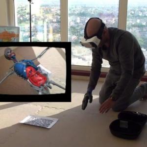 man with virtual reality glasses exploring human body