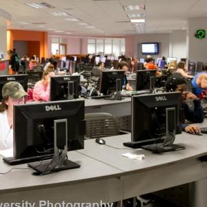 students working at computers it the tech center