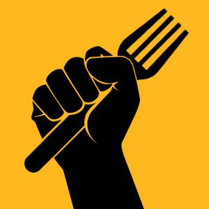 hand holding a fork