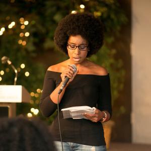 student reading poetry