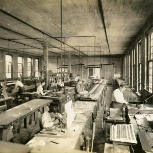 Photograph of workers etching labels onto saws at Disston Saw, Tool and File Works, Philadelphia, Pennsylvania, circa 1920s. United Saw, Files, and Steel Product Workers of America Records, Special Collections Research Center, Temple University Libraries.