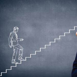 A chalk drawing of a man walking up stairs.