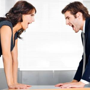 two people having an argument in business casual wear.