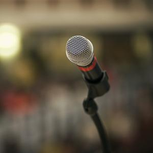 A picture of microphone on a stand.