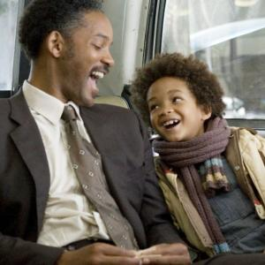 "A picture of Will Smith and son Jaden sitting on a bus during a scene during the movie ""The Pursuit of Happyness"""