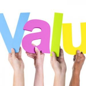 """Hands holding up letters that spell out the word """"values"""""""