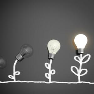 Light bulbs getting brighter to represent growing up and adulthood