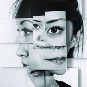 An image of a woman formed into a collage which is meant to represent identity conflict.