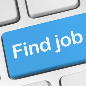 "a button on the computer keyboard in blue that says ""find job""."