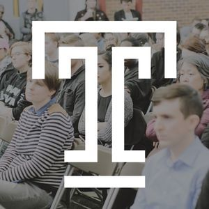 Temple T logo over a stock photo of an audience