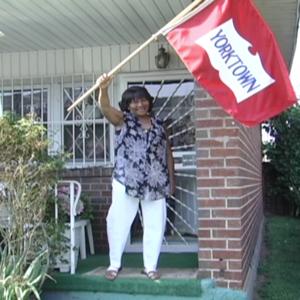 Person waving a Yorktown flag