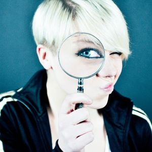 Person with a magnifying glass
