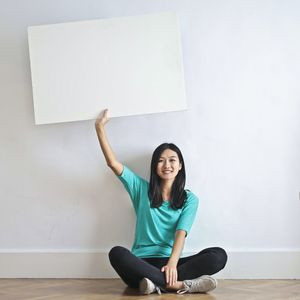 Person holding a poster