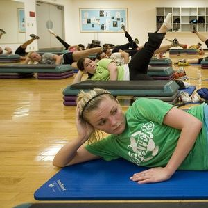 Patrons participating in a Pilates session.