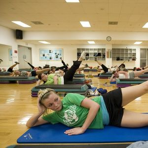 Patrons participating in a Pilates group fitness session.