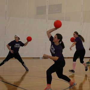 A team of dodgeball players preparing to throw.