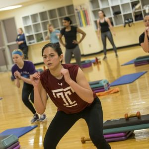 Patrons participating in a Group Fitness Session in the IBC Student Recreation Center.