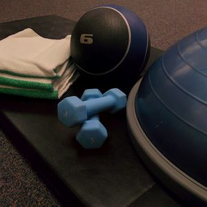 Workout equipment sitting on a foam pad.