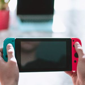 Hands holding a Switch.