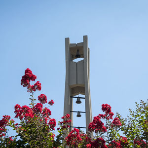 Temple bell tower and flowers