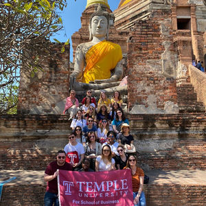fox business school students in front of temple
